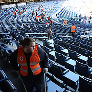 Cleaner prepare the stadium for game two during the New York Yankees V Chicago Cubs, double header game one at Yankee Stadium, The Bronx, New York. 16th April 2014. Photo Tim Clayton