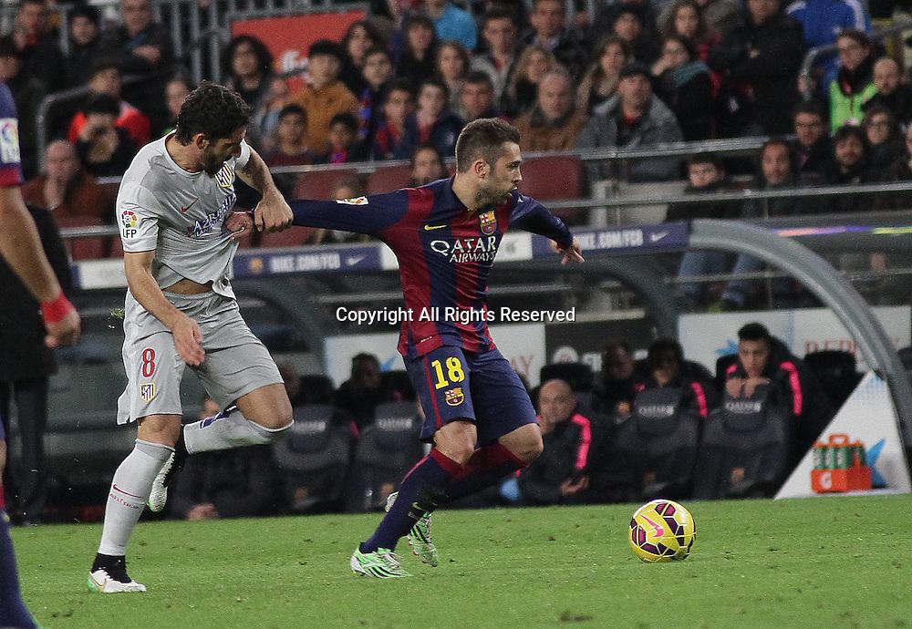 11.01.2015. Barcelona, Spain. La liga football. Barcelona versus Atletico Madrid.  Alba Challenged by Raul Garcia (L)