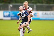 Bradford Bulls loose forward Damian Sironen (10) eyes up Swinton Lions Isaac Farrell (25) during the Kingstone Press Championship match between Swinton Lions and Bradford Bulls at the Willows, Salford, United Kingdom on 20 August 2017. Photo by Simon Davies.