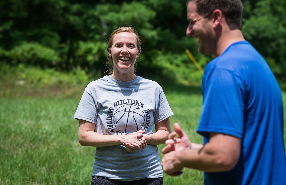 """Master's in Athletic Administration students Pam Van Bellen, left, and Xander Jones share a laugh during the """"Two Truths and A Lie"""" ice breaker at The Ridges on Friday, June 26, 2015. © Ohio University / Photo by Rob Hardin"""