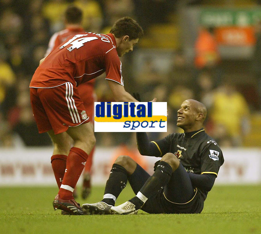 Photo: Aidan Ellis.<br /> Liverpool v Watford. The Barclays Premiership. 23/12/2006.<br /> Liverpool's Xabi Alonso shares a joke with Watford's Jordan Stewart after a late challenge by Alonso
