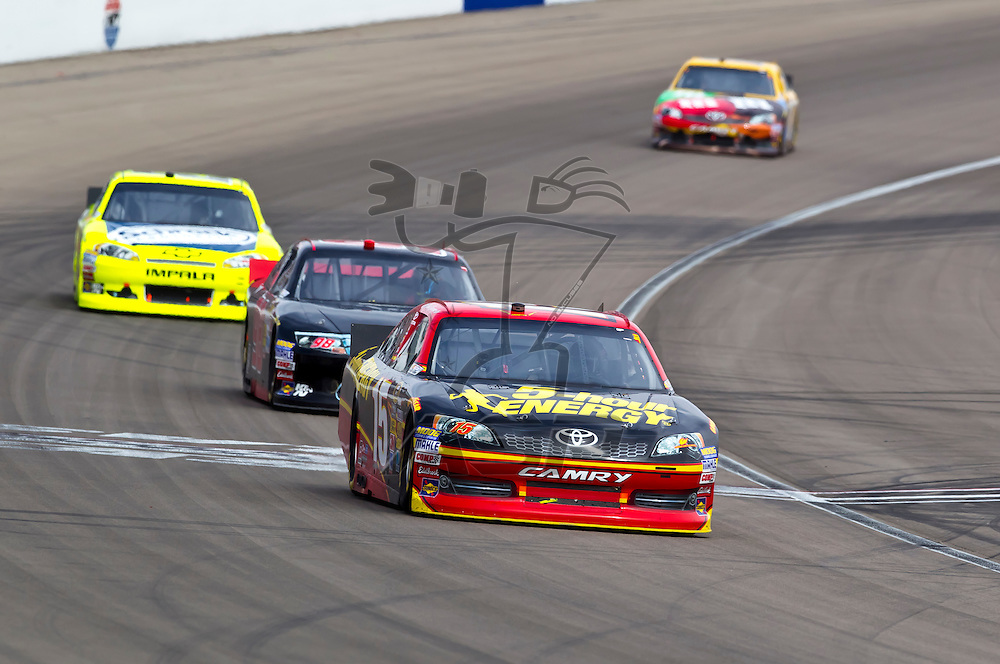 LAS VEGAS, NV - MAR 11, 2012:  Clint Bowyer (15) battle for position during the Kobalt Tools 400 race at the Las Vegas Motor Speedway in Las Vegas, NV.
