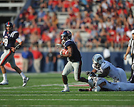 Ole Miss' Jeff Scott (3) eludes Southern Illinois' Travis Littles (3) and Southern Illinois' Boo Rodgers (29) to score at Vaught-Hemingway Stadium in Oxford, Miss. on Saturday, September 10, 2011. Ole Miss won 42-24.