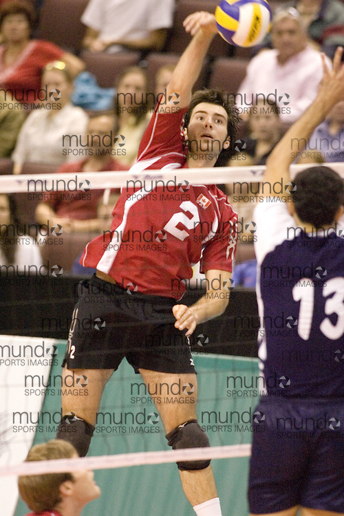 Christian Bernier hitting as Tunisia defeats Canada three games to two in the 2006 Anton Furlani Volleyball Cup.. .Copyright Sean Burges / Mundo Sport Images, 2006 .Anton Furlani Cup.Copyright Sean Burges / Mundo Sport Images, 2006