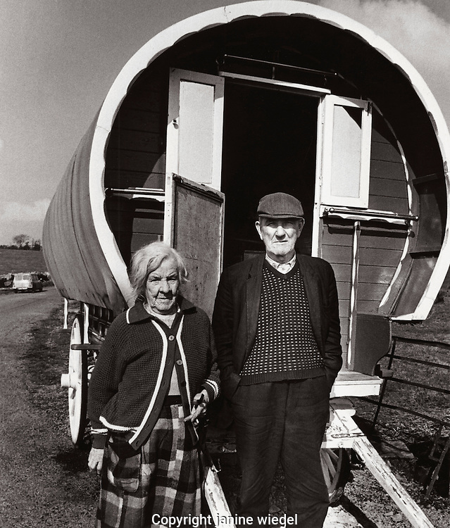 Irish Traveller couple with bow shaped caravan in Southern Ireland 1970s