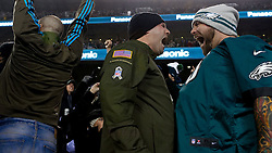 Jesse McLean and Bob Nadler of Toms river, N.J., react to an Eagles play. <br /> <br /> Check elsewhere on this site for all images of this shoot. Selected images are published as part of photo essay on WHYY's NewsWorks.org. - http://www.newsworks.org/index.php/local/item/89516-young-champions-celebrated-at-eagles-game-photos<br /> <br /> (©2015, All Rights reserved - Bastiaan Slabbers/BasSlabbers.com)