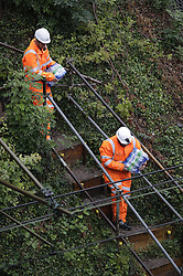 © Licensed to London News Pictures. 16/09/2016. Watford, UK. Network Rail workers carry water to where a landslide has derailed near Watford, following heavy rainfall over night. A train is stuck in the tunnel. Photo credit: Peter Macdiarmid/LNP