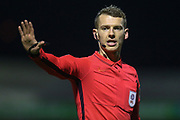 Referee Will Finnie pointing, directing, signalling during the EFL Trophy match between Southend United and AFC Wimbledon at Roots Hall, Southend, England on 13 November 2019.
