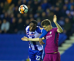 WIGAN, ENGLAND - Monday, February 19, 2018: Wigan Athletic's Chey Dunkley and Manchester City's John Stones during the FA Cup 5th Round match between Wigan Athletic FC and Manchester City FC at the DW Stadium. (Pic by David Rawcliffe/Propaganda)
