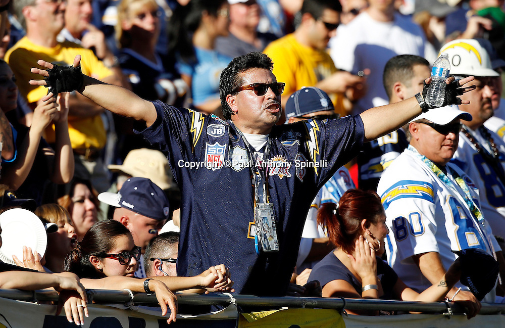A San Diego Chargers fan spreads his arms and cheers during the NFL week 14 football game against the Kansas City Chiefs on Sunday, December 12, 2010 in San Diego, California. The Chargers won the game 31-0. (©Paul Anthony Spinelli)