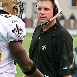 26 August 2006: First year New Orleans Saints head coach Sean Payton talks to rookie running back Reggie Bush during a NFL preseason game between the Indianapolis Colts against the New Orleans Saints at Veterans Memorial Stadium in Jackson, Mississippi.