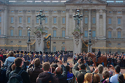 Crowd photographing the changing of the guard at Buckingham Palace, London