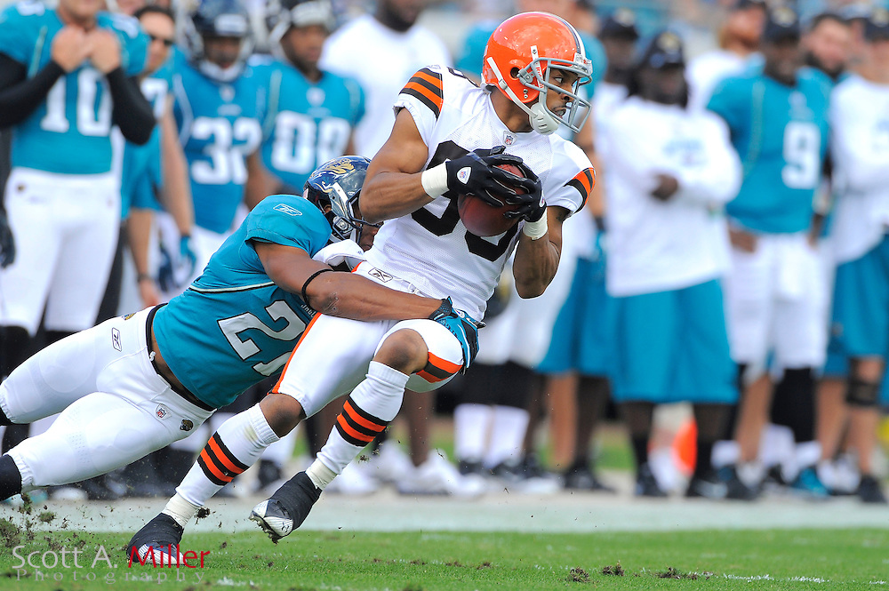 Cleveland Browns wide receiver Chansi Stuckey (83) is tackled by Jacksonville Jaguars cornerback Derek Cox (21) during the Jags 24-20 win over the Browns at EverBank Field on November 21, 2010 in Jacksonville, Florida...©2010 Scott A. Miller