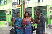 Chika Chukwu with her staff outside a local petrol station that bought paint from her. The manager saw the colours in her office and copied the look on his petrol station.<br /> <br /> Chika set up and runs Decency Paints, which sells paint.<br /> <br /> Chika set up her business just over a year ago. The biggest thing that she has learnt from the Youth for Technology training is about managing and investing money. She used to think you needed lots of money to grow the business but now understand you can invest small amounts too.