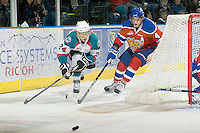 KELOWNA, CANADA - FEBRUARY 15: Tyson Baillie #24 of the Kelowna Rockets and Keegan Lowe #4 of the Edmonton Oil Kings skate for the puck at the Kelowna Rockets on February 15, 2012 at Prospera Place in Kelowna, British Columbia, Canada (Photo by Marissa Baecker/Getty Images) *** Local Caption *** Tyson Baillie; Keegan Lowe;