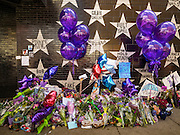 "22 APRIL 2016 - MINNEAPOLIS, MN: The memorial for Prince at 1st Ave, a nightclub and concert venue in Minneapolis. Thousands of people came to 1st Ave in Minneapolis Friday to mourn the death of Prince, whose full name is Prince Rogers Nelson. 1st Ave is the nightclub the musical icon made famous in his semi autobiographical movie ""Purple Rain."" Prince, 57 years old, passed away Thursday, April 21, 2016, at Paisley Park, his home, office and recording complex in Chanhassen, MN.  PHOTO BY JACK KURTZ"