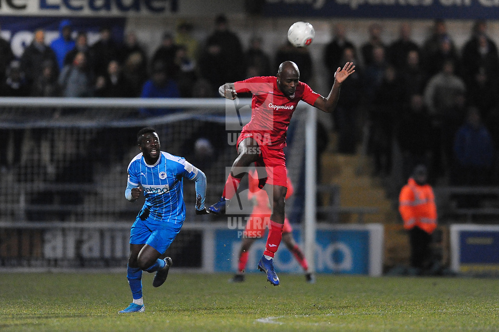 TELFORD COPYRIGHT MIKE SHERIDAN Theo Streete of Telford heads clear from Elton Ngwatala during the Vanarama Conference North fixture between AFC Telford United and Chester at the 1885 Arena Deva Stadium on Saturday, December 21, 2019.<br /> <br /> Picture credit: Mike Sheridan/Ultrapress<br /> <br /> MS201920-035