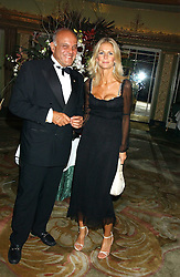Centre, ULRIKA JONSSON and heart surgeon SIR MAGDI YACOUB at the Chain of Hope 10th Anniversary Ball held at The Dorchester, Park Lane, London on 1st November 2005.<br />
