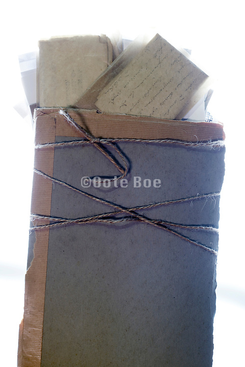 old letters in envelope bound together with carton protection