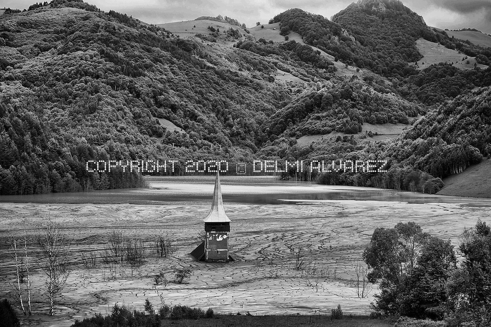 A church drowned within the tailing pond of the Rosia Poieni copper mine next to Lupsa village, 460 km west of Bucharest, Romania. Near here the romanian government will open a pit gold mine managed by a canadian company and it is the biggest one gold mine n Europe.