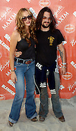 "ATLANTIC CITY, NJ - JUNE 26: Actress Drea De Matteo (L) and her boyfriend Shooter Jennings arrive at the Maxim Magazine Presents ""Fantasy Island"" at the Borgata Hotel Casino and Spa June 26, 2004 in Atlantic City, New Jersey. The event consisted of two music stages and four unique themed areas, providing a wide array of entertainment for guests; South Beach Venice Beach, Stuffland, and The Oasis. (Photo by William Thomas Cain/Getty Images)"