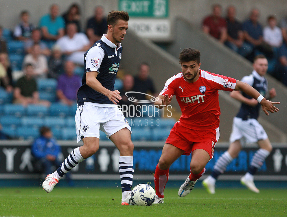 Millwall player Jack Powell passes under pressure from Chesterfield player Sam Morsy during the Sky Bet League 1 match between Millwall and Chesterfield at The Den, London, England on 29 August 2015. Photo by Bennett Dean.
