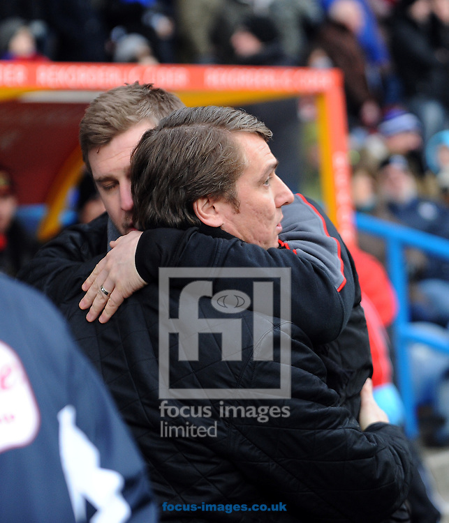 Picture by Graham Crowther/Focus Images Ltd. 07763140036.04/02/12.Lee Clark manager of Huddersfield Town greets Karl Robinson manager of MK Dons before the Npower League 1 game at The Galpharm Stadium Stadium, Huddersfield.