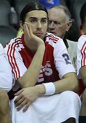 Apr 11; Newark, NJ, USA; New Jersey Nets shooting guard Sasha Vujacic (20) sits on the bench during the second half at the Prudential Center. The Bobcats defeated the Nets 105-103.