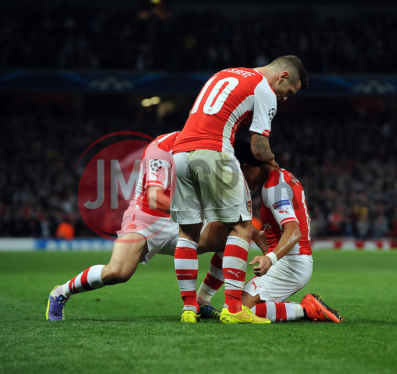 Arsenal's Alexis Sanchez celebrates his goal with Arsenal's Jack Wilshere - Photo mandatory by-line: Joe Meredith/JMP - Mobile: 07966 386802 27/08/2014 - SPORT - FOOTBALL - London - Emirates Stadium - Arsenal v Besiktas - Champions League