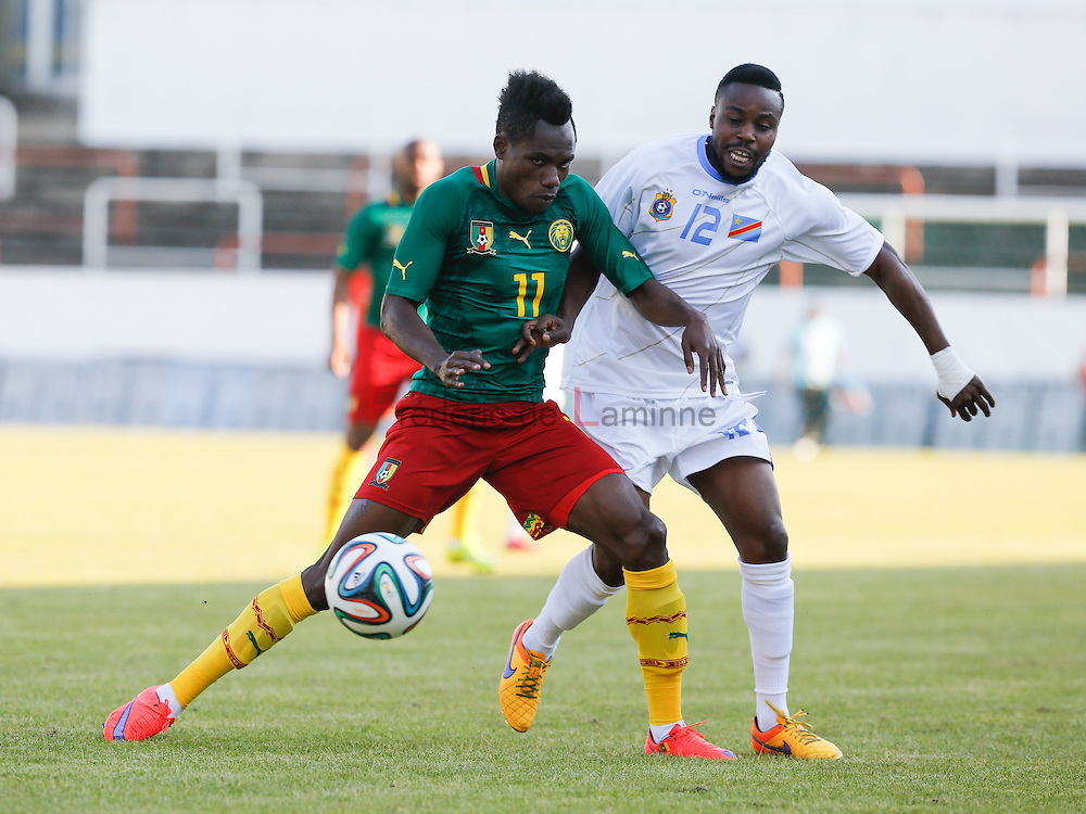 20150609 - Mons, Belgium : Cameroun's forward Justin MENGOLO (#11) and DR Congo's Mid-fielder Toko NZUZI (#12) compete for the ball  during the friendly football game between Democratic Replublic of Congo and Cameroun on 09/06/2015 in Mons (Albert)