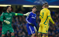 LONDON, ENGLAND - Wednesday, December 10, 2014: Chelsea's Diego Costa and Sporting Clube de Portugal's goalkeeper Rui Patricio during the final UEFA Champions League Group G match at Stamford Bridge. (Pic by David Rawcliffe/Propaganda)
