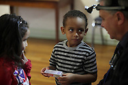 Middletown, New York - Dentist Thomas Littner examines children's teeth at Middletown Head Start on Nov. 30, 2012.