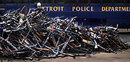 Ranging from antique muzzle loaders to AK 47's, half of the 5,000 long guns that had piled up in the overburdened property room at Detroit Police Headquarters since the mid-1970's, are piled high before being melted down at the Rouge Steel plant in Dearborn .