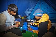 Bharat Bhushan and Tipu preparing their last cup of lemon tea of the day in their tent at KalaBagh, near Churdhar, Chopal, Himachal Pradesh, India