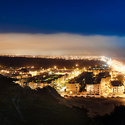 Ocean beach is seen from Sutro Heights on a moonlit night in the outer sunset district of San Francisco, California.
