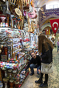 Young woman tourist shopping in The Grand Bazaar, Kapalicarsi, great market in Beyazi, Istanbul, Republic of Turkey