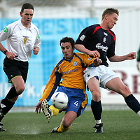 Falkirk v St Johnstone..20.11.04<br />David Hannah is tackled by Daniel McBreen<br /><br />Picture by Graeme Hart.<br />Copyright Perthshire Picture Agency<br />Tel: 01738 623350  Mobile: 07990 594431