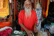 Garland maker near the Thanumalayan temple in Suchindram. near Kanyakumeri.