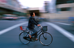 CHINA SHANGHAI NOV01 - Cyclist careers down main traffic artery in downtown Shanghai.. . jre/Photo by Jiri Rezac. . © Jiri Rezac 2001. . Contact: +44 (0) 7050 110 417. Mobile:  +44 (0) 7801 337 683. Office:  +44 (0) 20 8968 9635. . Email:   jiri@jirirezac.com. Web:     www.jirirezac.com