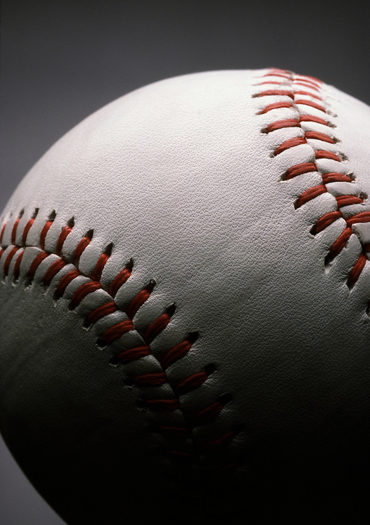 Dramatically lit close up of a major league baseball