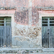 Old doorways facing the street in the Spanish colonial town of Valladolid in the heart of Mexico's Yucatan Peninsula