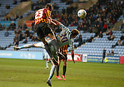 Rory McArdle climbs highest to get in his header during the Sky Bet League 1 match between Coventry City and Bradford City at the Ricoh Arena, Coventry, England on 10 March 2015. Photo by Simon Kimber.