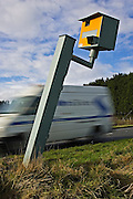 Traffic passes vandalised Gatso speed camera on A40, Oxfordshire, England, United Kingdom