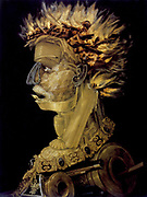 Fire',  Oil on wood. Giuseppe Arcimboldo (c1530-1593) Italian painter. Bizarre 'portrait' composed of articles associated with fire including  guns, candle, oil lamp, wood and wax taper.