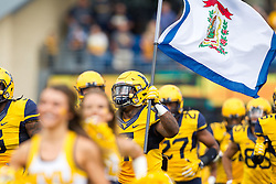 Oct 1, 2016; Morgantown, WV, USA; West Virginia Mountaineers running back Rushel Shell (7) leads the team out on the field prior to their game against the Kansas State Wildcats at Milan Puskar Stadium. Mandatory Credit: Ben Queen-USA TODAY Sports