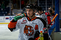 KELOWNA, BC - NOVEMBER 8:  Ryan Chyzowski #29 of the Medicine Hat Tigers stands at the bench during warm up against the Kelowna Rockets at Prospera Place on November 8, 2019 in Kelowna, Canada. (Photo by Marissa Baecker/Shoot the Breeze)