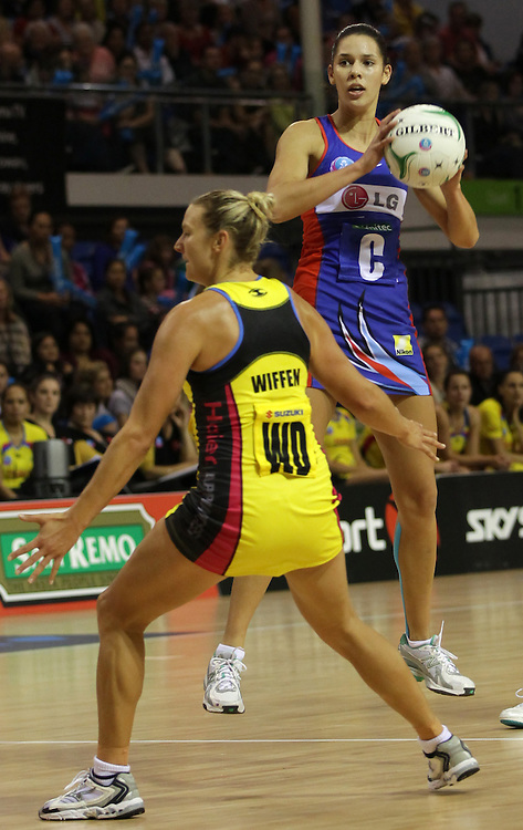 Mystics' Kayla Cullen jumps above Pulse's Daya Wiffen in round 5 of the 2013 ANZ Netball Championship, Trusts Stadium, Auckland, New Zealand, Sunday, April 21, 2013.  Credit:SNPA / David Rowland