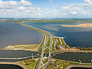 Nederland, Friesland, Gemeente Wonseradeel, 16-04-2012; Afsluitdijk ter hoogte van Kornwerderzand, gezien naar de kust van Friesland. Op het voormalig werkeiland liggen de Lorentzsluizen, een complex van schutsluizen en spuisluizen (buiten beeld). De sluizen worden beschermd door kazematten (bunkers). Rechts natuurreservaat De Makkumer noordwaard..Enclosure Dam at the height of Kornwerderzand seen in the direction of the coast of Friesland. On the former work island the Lorentz locks, a complex of sluices and locks. The locks are protected by bunkers..luchtfoto (toeslag), aerial photo (additional fee required).foto/photo Siebe Swart