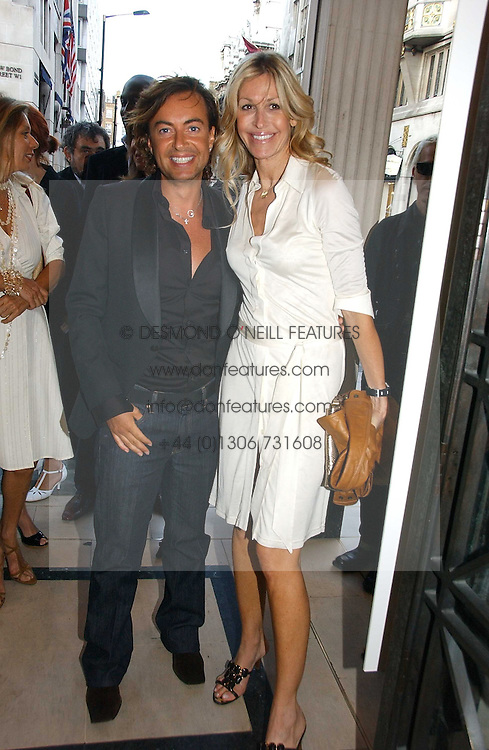 JULIEN MACDONALD and MELISSA ODABASH at a party to celebrate the re-opening of the David Morris Flagship store at 180 New Bond Street, London on 14th June 2006.<br />