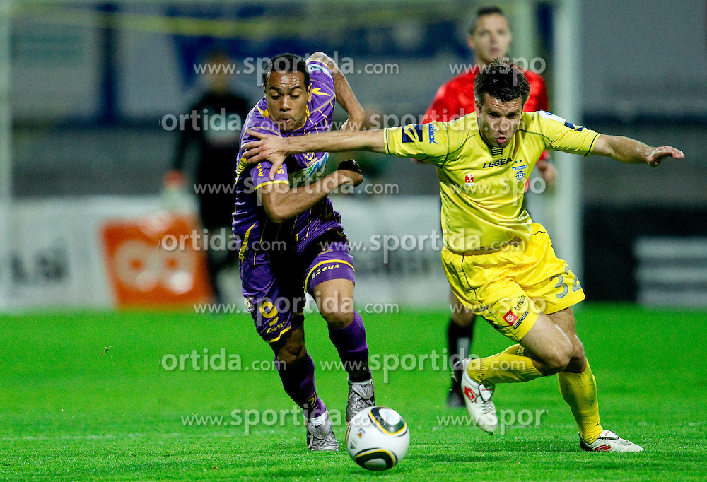 Marcos Tavares vs Luka Elsner during football match between NK Domzale and NK Maribor in 27th Round of Slovenian 1st League PrvaLiga, on April 9, 2011 in Sports park Domzale, Slovenia.  (Photo By Vid Ponikvar / Sportida.com)